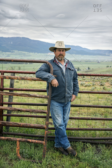 USA, Oregon,  - May 15, 2015: Enterprise, Portrait of Cowboy and Rancher Todd Nash at a ranch in North East Oregon between Enterprise and Joseph, looking towards the Eagle Cap Wilderness and the Wallowa Mountains, Wallowa-Whitman National Forest