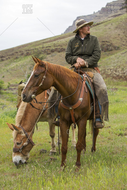 USA, Oregon, Joseph,  - May 15, 2015: portrait of cowboy Cody Ross in the canyon up Big Sheep Creek in Northeast Oregon