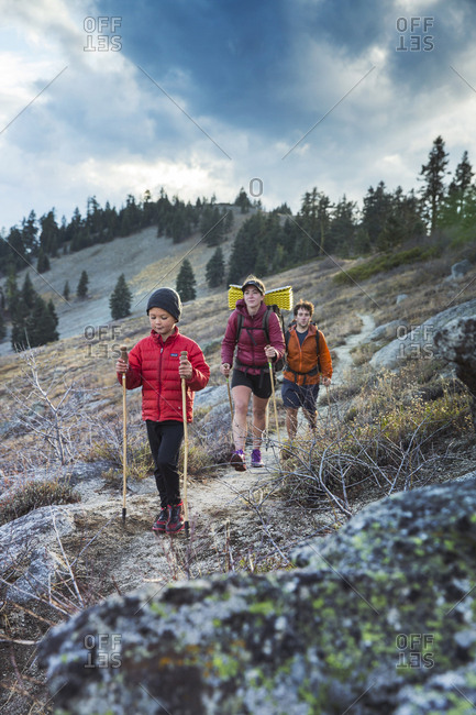 USA, Oregon, Ashland, - October 30, 2014:  6 year old Christian Rego aka Buddy Backpacker hikes a section of the Pacific Crest Trail near Ashland Oregon with his mom Andrea Rego and Dion, Christian will be the youngest hiker to complete the Pacific Crest Trail in a single season