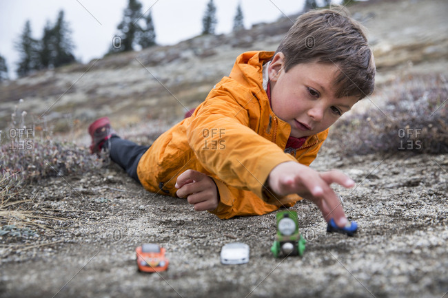 USA, Oregon, Ashland, - October 30, 2014:  portrait of 6 year old Christian Rego aka Buddy Backpacker taking a break while hiking the Pacific Crest Trail near Ashland Oregon with his mom Andrea Rego and Dion, Christian will be the youngest hiker to complete the Pacific Crest Trail in a single season