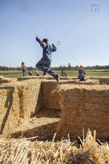 USA, Oregon, Bend, - October 6, 2012:  children play on the hay maze at the annual pumpkin patch located in Terrebone near Smith Rock State Park