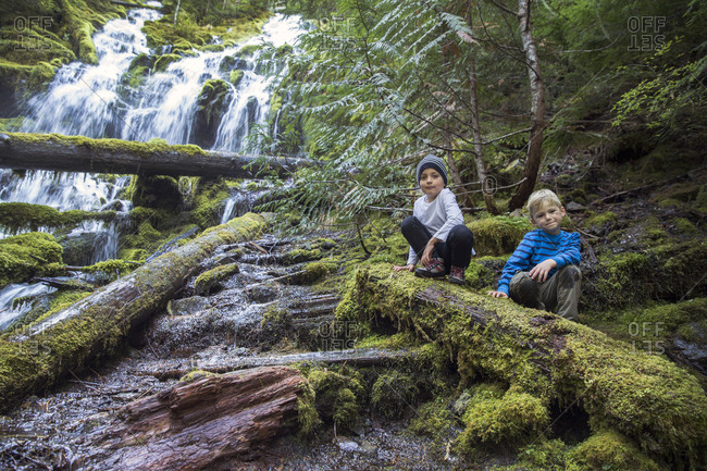 USA, Oregon, Oregon Cascades,  - September 28, 2014: young boys hike and check out the upper Proxy Falls in the Wilamette National Forest in the early Fall, McKenzie Pass
