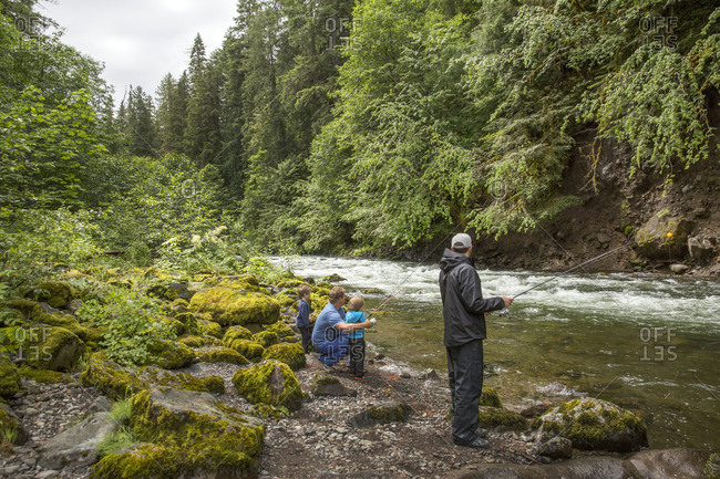 USA, Oregon, Santiam River, - June 28, 2014:  , young boys learning how to fish on the Santiam River in the Willamete National Forest