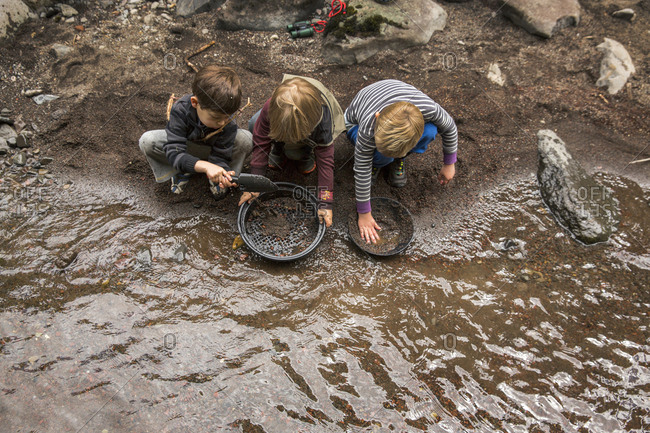 USA, Oregon, Santiam River, - June 29, 2014:  , young boys play in the sand along the Santiam River in the Willamete National Forest