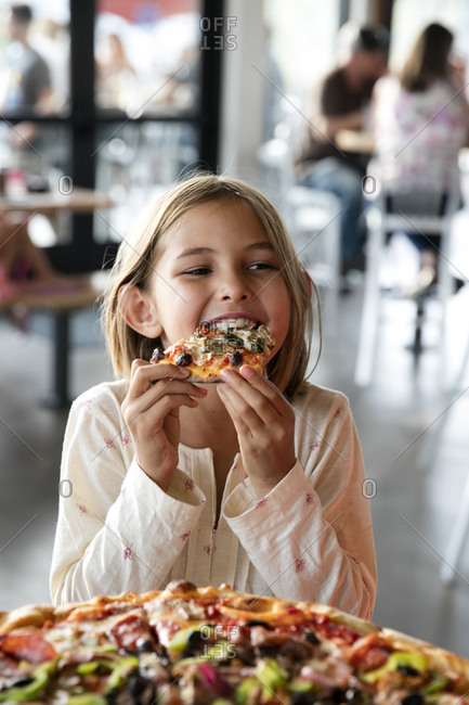 USA, Oregon, Bend,  - August 29, 2015: Pacific Pizza and Brew, girl eating pizza