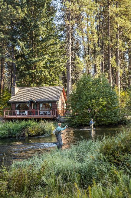 USA, Oregon,  - September 11, 2015: Camp Sherman, Metolius River Resort, Fly fishermen on the Metolius looking away from resort
