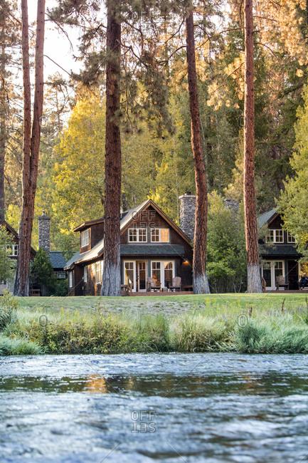USA, Oregon,  - September 11, 2015: Camp Sherman, Metolius River Resort, View of cabins from River