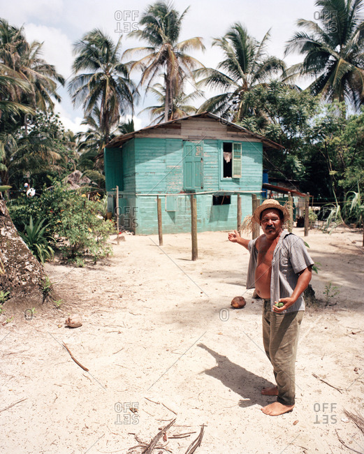 PANAMA, Bocas del Toro, - March 20, 2017:  a local man in front of his home by the Caribbean Sea, Central America