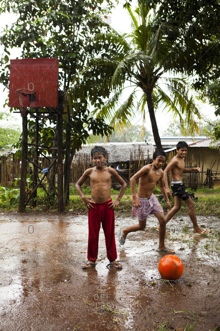 PHILIPPINES, Palawan, Puerto Princesa,  - February 5, 2011: Ian, Marvin and Nestor play basketball on Abanico Road in Barangay Village, San Pedro