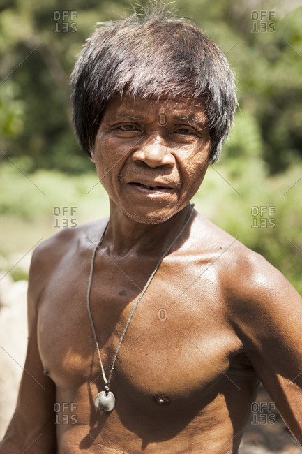 PHILIPPINES, Palawan, Barangay region,  - February 7, 2011: Batak man Rudolfo de la Cruz makes charcoal in the small village Purok Tarabidan