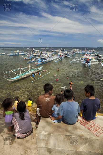PHILIPPINES, Palawan, Sabang,  - February 8, 2011: boats line up in Sabang to take people to sese see the Underground River