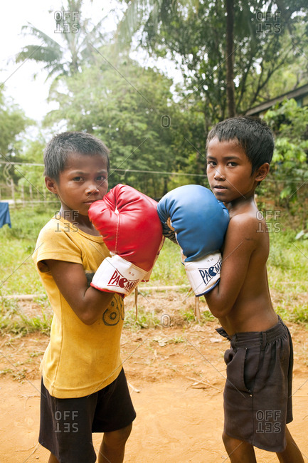 PHILIPPINES, Palawan, Sabang,  - February 9, 2011: young boys practice their boxing in the countryside near Sabang beneath the Marble Mountains