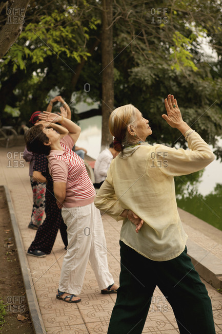 VIETNAM, Hanoi,  - April 12, 2010: women practice Tai Chi early in the morning, Hoan Kiem Lake