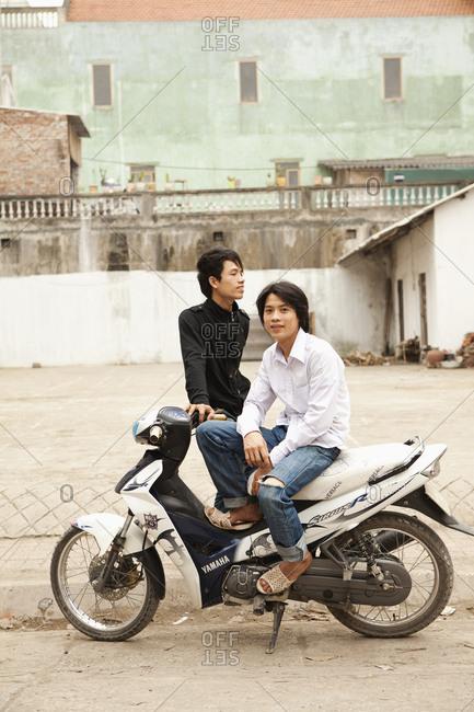VIETNAM, Hanoi, Bathranag Village, - April 13, 2010: a portrait of two friends on the side of the road