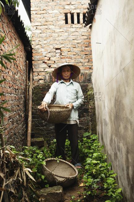 VIETNAM, Hanoi,  - April 13, 2010: Hanoi countryside, portrait of rice farmer Nguyen Huu Uc at his home in Nguyen Huu Y village