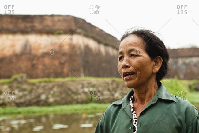VIETNAM, Hue,  - April 16, 2010: portrait of Ngo Thi Hoa on the outside of the Citadel walls