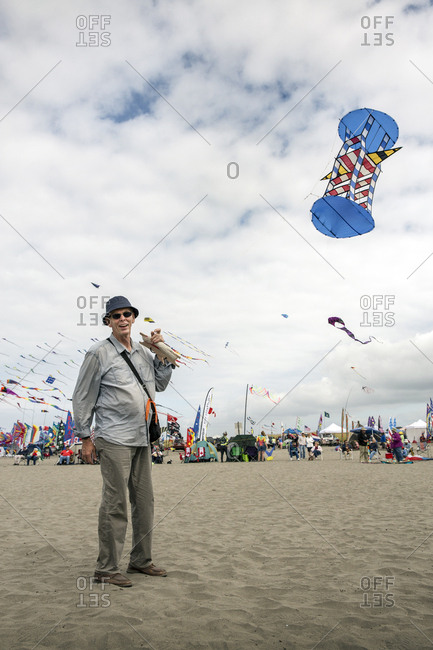 USA, Washington State, Long Beach Peninsula,  - August 21, 2014: International Kite Festival, French kite competitor and 3D kite builder Loik Lamalle