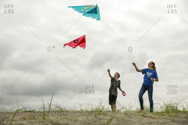 USA, Washington State, Long Beach Peninsula,  - August 21, 2014: a brother and sister battle with their kites at the International Kite Festival