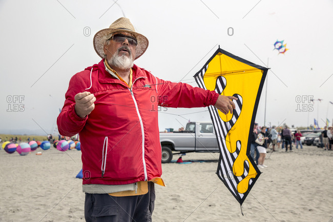 USA, Washington State, Long Beach Peninsula, - August 23, 2014: Ron Gibian with his bearded man face kite at the International Kite Festival, Ron is a member of the Phoenix Kite Collective