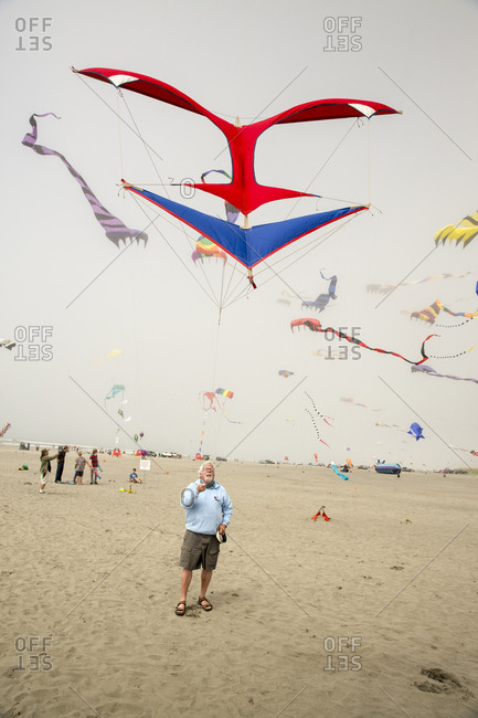 USA, Washington State, Long Beach Peninsula, - August 23, 2014: International Kite Festival, Jim Day with his blue and red reproduction of a 1920's design