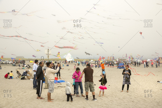 USA, Washington State, Long Beach Peninsula, - August 23, 2014: International Kite Festival, family flies a kite at the kite festival