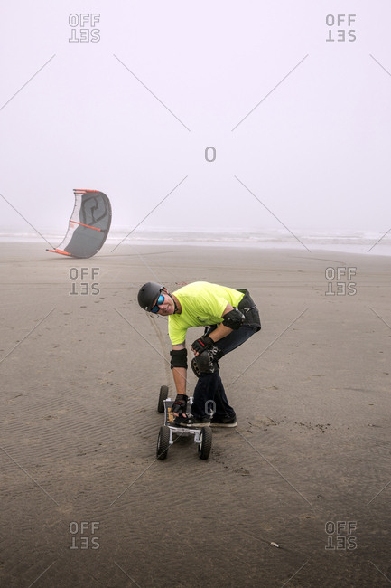 USA, Washington State, Long Beach Peninsula, - August 23, 2014: International Kite Festival, power beach kite boarding in the fog