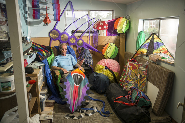USA, Washington State, Long Beach Peninsula, - August 23, 2014: International Kite Festival, kite flyer, collector and builder in his home in Long Beach, he owns 300 kites