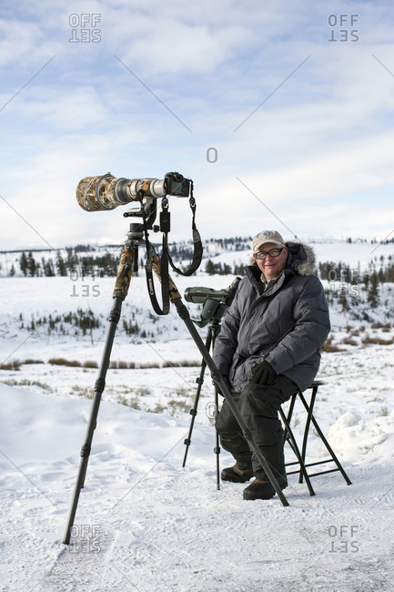 USA, Wyoming, Yellowstone National Park,  - January 1, 2000: wolf-watcher Bob Breslaw takes a break from watching a pack on Balcktail Deer Plateau