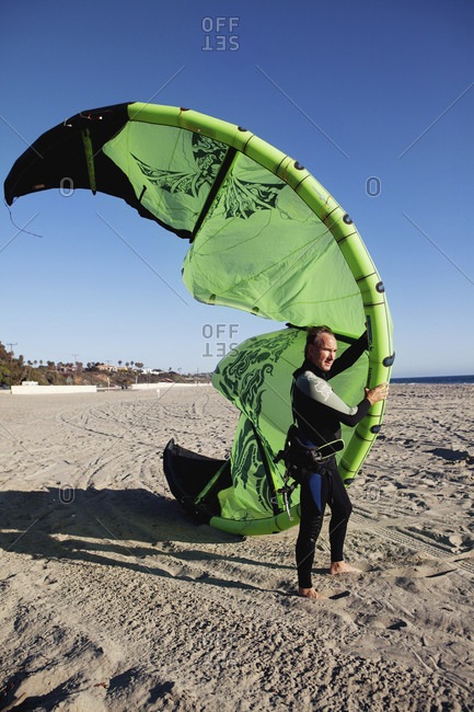 USA, California, Malibu,  - October 8, 2010: a kite surfer gets ready to enter the water, Broad Beach