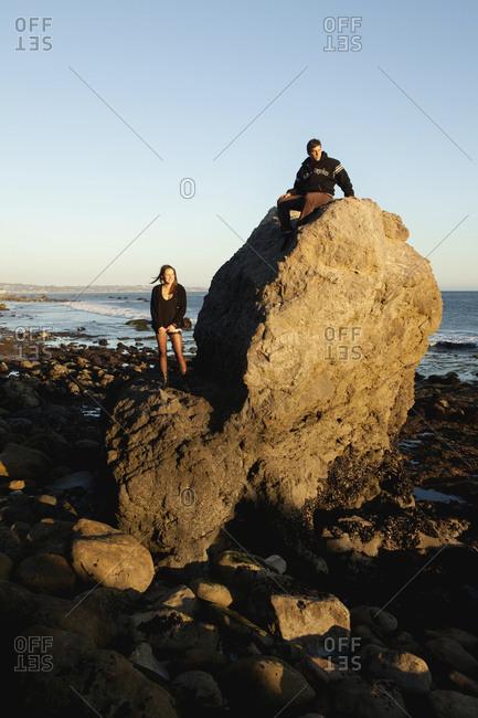 USA, California, Malibu,  - October 8, 2010: El Pescador Beach, Parker and his friend April explore the coastline at the end of the day