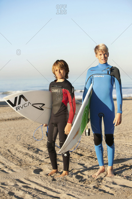 USA, California, Malibu,  - October 10, 2010: portrait of young male surfers at Zuma Beach