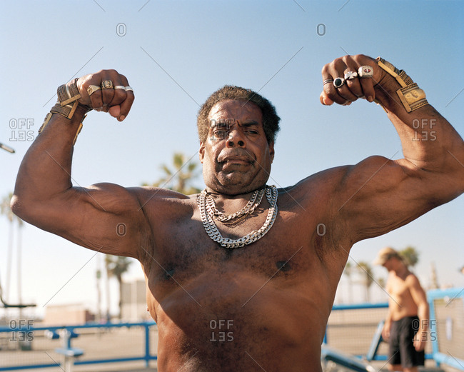 USA, California, Los Angeles, - March 21, 2017:  a bodybuilder strikes a pose at Muscle Beach in Venice Beach