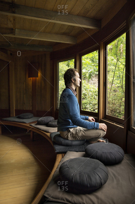 USA, California, Big Sur, Esalen,  - May 13, 2013: a man sits and performs a sitting meditation in the Meditation Center at the Esalen Institute