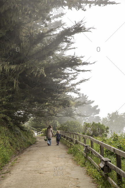 USA, California, Big Sur, Esalen,  - May 13, 2013: mother and daughter walk on a path at the Esalen Institute