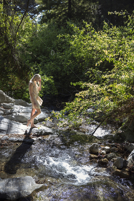 USA, California, Big Sur, Esalen,  - May 13, 2013: a woman walks down to Hot Springs Creek at the Esalen Institute