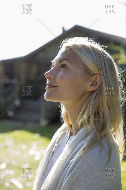 USA, California, Big Sur, Esalen,  - May 13, 2013: portrait of a young woman in front of the Farm House at the Esalen Institute