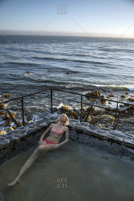 USA, California, Big Sur, Esalen,  - May 13, 2013: a woman sits in the Baths and relaxes at the Esalen Institute