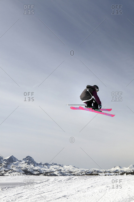 USA, California, Mammoth,  - March 4, 2011: a skier catches air off a jump at Mammoth Ski Resort