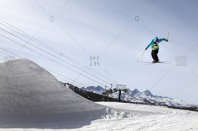 USA, California, Mammoth,  - March 4, 2011: a snowboarder catches air off a jump at Mammoth Ski Resort