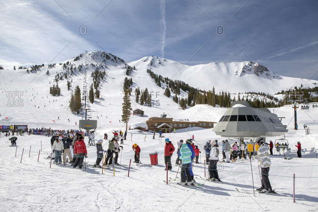 USA, California, Mammoth,  - March 5, 2011: skiers and snowboarders wait in line to ride the chairlift at Mammoth Ski Resort