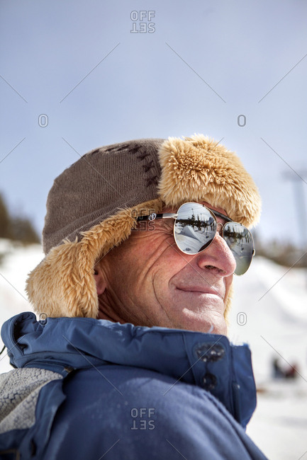 USA, California, Mammoth,  - March 4, 2011: a bystander watches the skiers and boarders compete at Mammoth Ski Resort