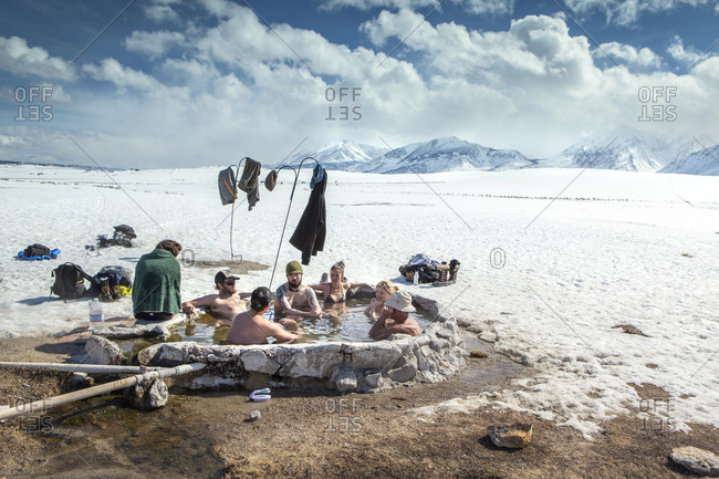USA, California, Mammoth,  - March 6, 2011: friends gather for a soak in the Mammoth Hot Springs