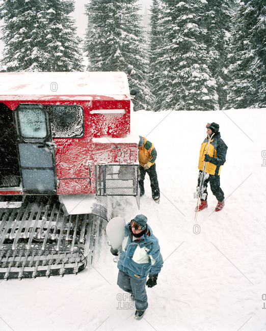 CANADA, BC Rockies,  - March 20, 2017: people standing outside of snow cat, Island Lake lodge, elevated view