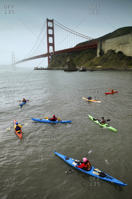USA, California, San Francisco, - March 11, 2012:  individuals endure the cold to kayak under the Golden Gate Bridge