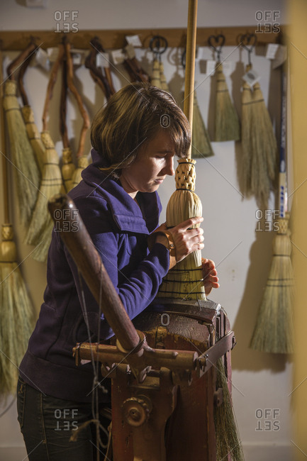 CANADA, Vancouver, British Columbia,  - May 27, 2013: Sarah Schwieger makes a broom by hand at the Broom Company on Granville Island