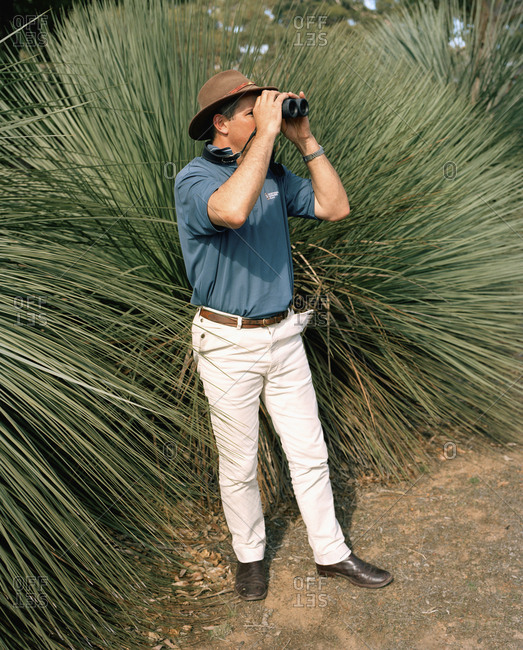 AUSTRALIA, Kangaroo Island, - January 22, 2010:  guide Craig Wickham, owner of Exceptional Kangaroo Island Tours, looking through binoculars