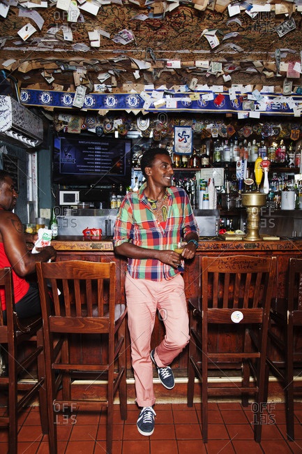 BERMUDA.  - September 12, 2015: Chef Marcus Samuelsson having the famous Rum Swizzle at the Swizzle Inn at Bailey's Bay.