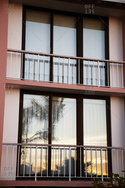 BERMUDA.  - September 12, 2015: Hamilton. Balcony doors with reflection of the sunset at the Hamilton Princess & Beach Club Hotel.