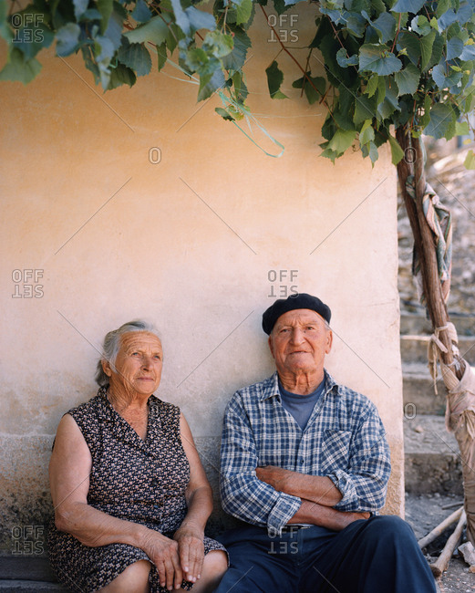 CROATIA, Hvar, Dalmatian Coast,  - September 28, 2010: Ivan Tomisic and Vica Tomisic sitting outside house their house in Hvar Island.