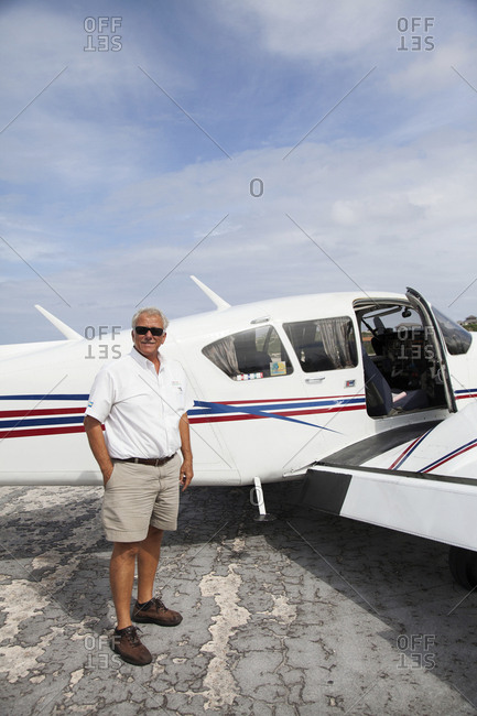 EXUMA, Bahamas.  - October 26, 2011: A pilot and his plane. He takes passengers from Nassau to the Exuma Islands.